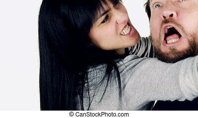 Woman hitting man fighting isolated closeup