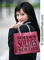 Woman hitting the French sales