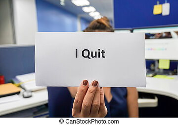woman hold a piece of paper of I quit the job