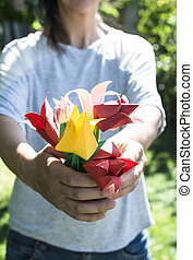 Woman hold bouquet of origami flowers