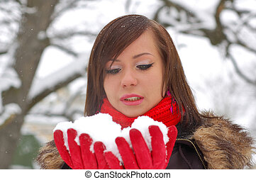 Woman hold snow in her hands