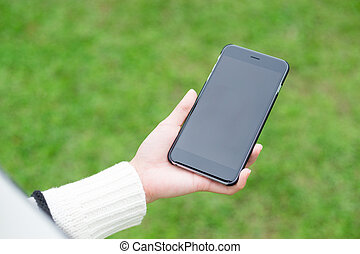 Woman hold with cellphone