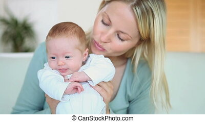Woman holding a baby in front of her