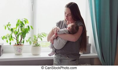 woman holding a baby in her arms