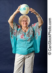 Woman holding a ball above her head.