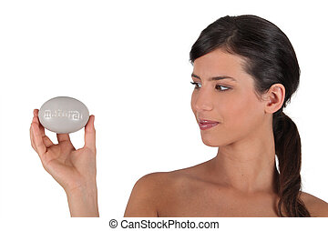 Woman holding a bar of soap