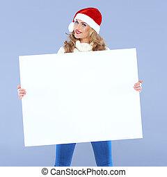 Woman holding a big blank sign - Woman wearing a Santa hat ...