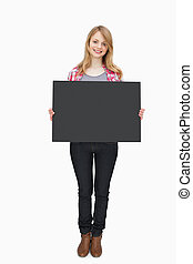 Woman holding a black board