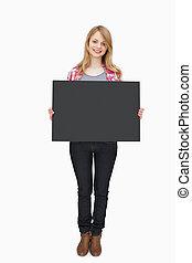 Woman holding a black board