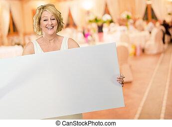 Woman Holding A Blank Billboard