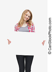Woman holding a blank board