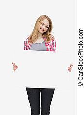Woman holding a blank board