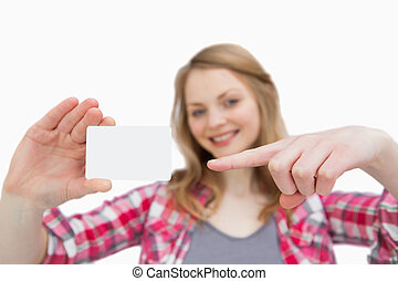 Woman holding a blank card while showing it
