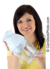 Woman holding a blender