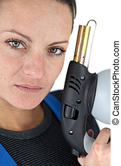 Woman holding a blowtorch