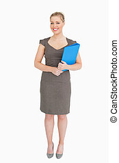 Woman holding a blue binder