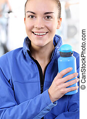 woman holding a blue bottle