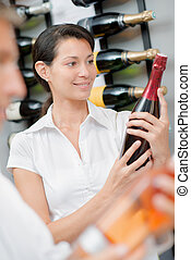 Woman holding a bottle of alcohol