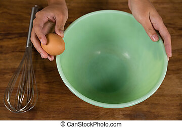 Woman holding a brown egg