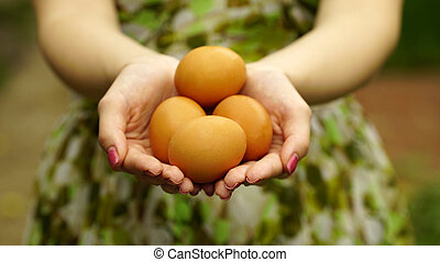 Woman holding a brown eggs