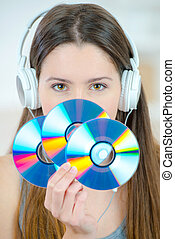 Woman holding a bunch of cds