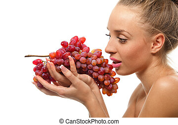 Woman holding a bunch of red grapes
