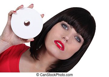 Woman holding a CD