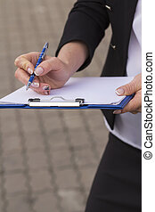 woman holding a clip board