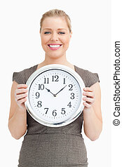 Woman holding a clock in her hands