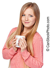 Woman holding a cup - Lovely blond female in pink knit ...
