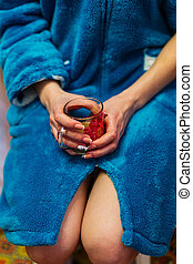 Woman holding a cup of tea in her hands