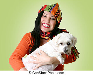Woman holding a dog in her arms