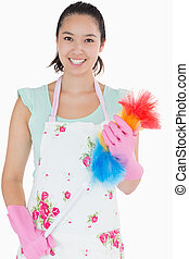 Woman holding a duster