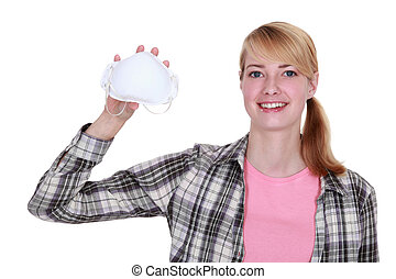 Woman holding a face mask