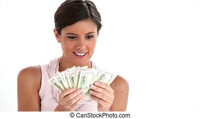 Woman holding a fan of dollars