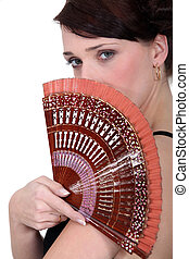 Woman holding a fan