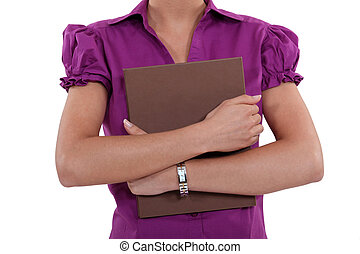 Woman holding a file to her chest