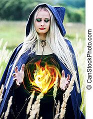 woman holding a fireball
