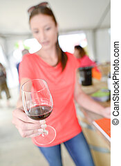 Woman holding a glass of red wine