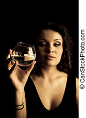 Woman holding a glass with a candle inside