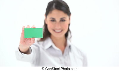Woman holding a green card