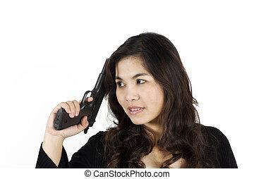 woman holding a gun on white background