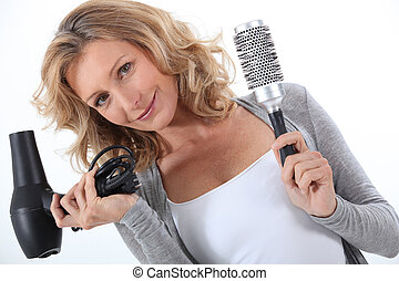Woman holding a hair dryer