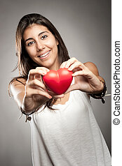 woman holding a heart