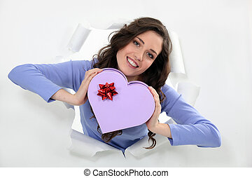 Woman holding a heart-shaped box
