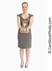 Woman holding a hourglass