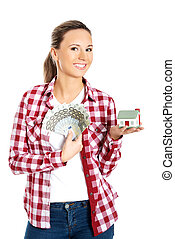 Woman holding a house model