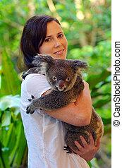 Woman holding a Koala