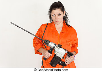 Woman holding a large portable drill