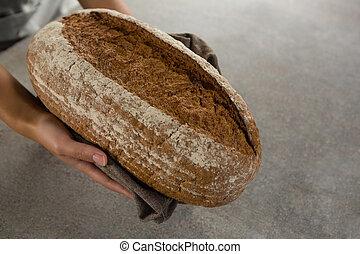 Woman holding a loaf of bread